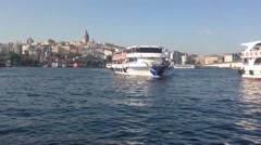 Ferry arriving with the Galata Tower on the background in Istanbul Turkey Stock Footage