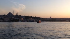 Pan from ferries to the Sunset at the Atatürk Bridge Stock Footage