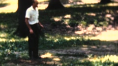 Men pitching horseshoes in the park Stock Footage