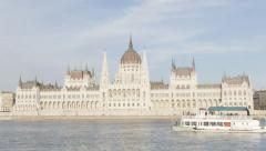 Hungarian parliament building on river Danube  and city of Budapest Stock Footage