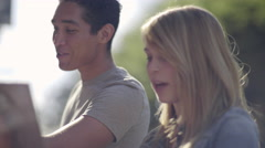 Young Woman Shows Her Boyfriend An Album Cover, Then They Continue Looking (4K) Stock Footage