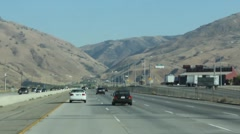 Driving on Los Angeles Golden State Hwy to Hollywood, California Stock Footage