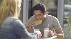 Cute Couple On A Date, Young Man Takes A Bite, Then Dunks Cookie In Milk (4K) Stock Footage