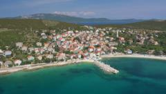 Aerial - Coastline town with turquoise colored water - stock footage