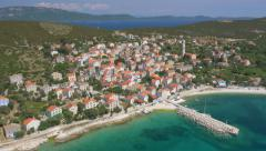 Aerial - Mediterranean island town Unije. Island Losinj in the background - stock footage