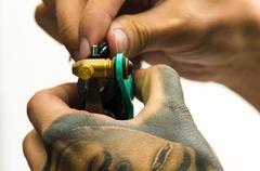 Tattoo machine fixing - stock photo