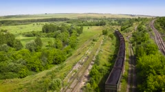 Movie in flight - Railway freight train loaded with coal moving away. 50fps - stock footage