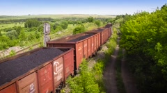 Movie in flight over Railway freight train loaded with coal. Near & over. 50fps Stock Footage