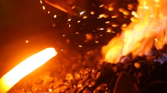 Forging a Swords with Fire Sparks - stock footage