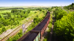 Video in flying over Railway freight train loaded with coal 25fps Stock Footage