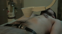 Radiological examination with scanner. Patient lying in hospital room, close up. Stock Footage
