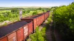 Flying movie over Railway freight train loaded with coal 25fps Stock Footage
