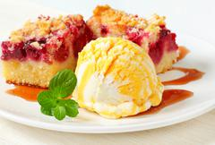 Berry fruit crumble cake with ice cream and syrup - stock photo