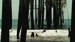 Under decaying columns hurricane damaged pier Stock Footage