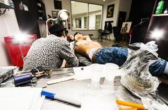 Inside tattoo studio - stock photo