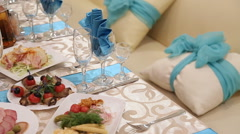 Served for a banquet table. Wine glasses with napkins, glasses and salads Stock Footage