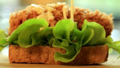 Making sandwich with lecture salad, fried pork, mayonnaise and salad dressing, f Stock Footage