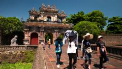 Hue, Vietnam- June 2015: Visitors exiting Citadel by ancient gate. 4K time lapse Stock Footage