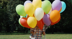 Electrified hair girl and a large number of balloons - stock footage