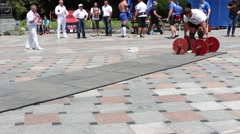 Strongman sport show. The farmer's walk. Stock Footage