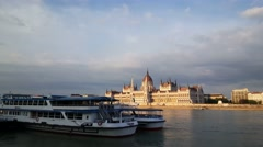 Cruise ships on the Danube Bank with the Hungarian Parliament Building Stock Footage
