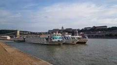 Cruise ships on the Danube Bank in Budapest, Hungary Stock Footage