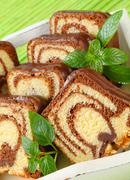 Slices of marble cake with chocolate icing - stock photo