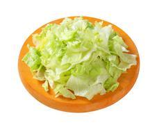 Iceberg lettuce salad on cutting board - stock photo