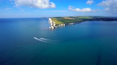 Old Harry Rocks cliffs South England UK with boats sailing - stock footage
