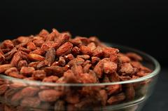 Dried goji berries on the table. Stock Photos