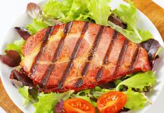 Grilled pork neck meat with salad greens - stock photo
