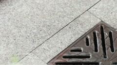 Rain Gutters on granite tile Stock Footage