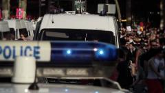 Police Cars arriving with large Crowd - 1080p Stock Footage