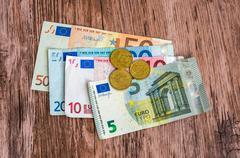 Euro banknotes and euro coins - stock photo