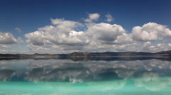 Time Lapse video clouds and reflections on Lake Salda, Mediterranean region Stock Footage
