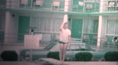 (8mm Vintage) 1966 Kids Diving Board At Motel Pool - stock footage