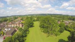 Aerial Wide Shot Ascending Countryside Trees Village Park Drone Footage Stock Footage