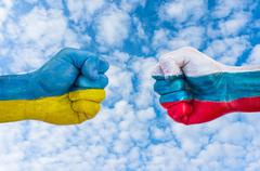 Fists world powers Ukraine and Russia vying with each other - stock photo