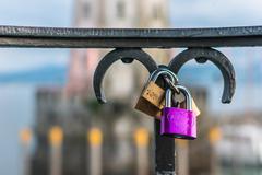 Love padlocks or love locks on a railing in the harbor of Lindau Stock Photos