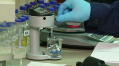 Laboratory, volumetric flask on a hotplate - stock footage