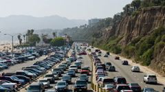 Cars driving commuters PCH commuting traffic rush hour Santa Monica highway LA Stock Footage