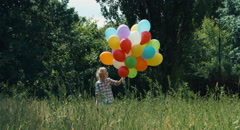 Stock Video Footage of Preschooler girl walking with balloons and in the park and waving hand