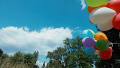 Stock Video Footage of Preschooler girl walking with balloons in the park
