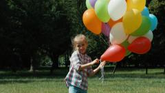 Stock Video Footage of Preschooler girl waving hand and playing with balloons