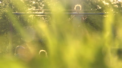 Сhildren on a swing in summer sunny playgroundng  4 Stock Footage