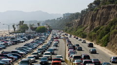freeway with cars commuting, commuters driving traffic Santa Monica ocean LA Stock Footage