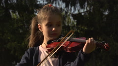 Girl playing the violin  Stock Footage