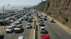 Cars in rush hour on PCH freeway in Santa Monica during rush hour traffic in LA Stock Footage