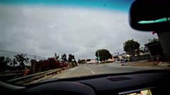 Driving Santa Monica, coming to red light intersection slowing down LA Stock Footage