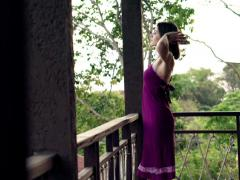 Young woman walking out on terrace and stretching her arms  NTSC Stock Footage